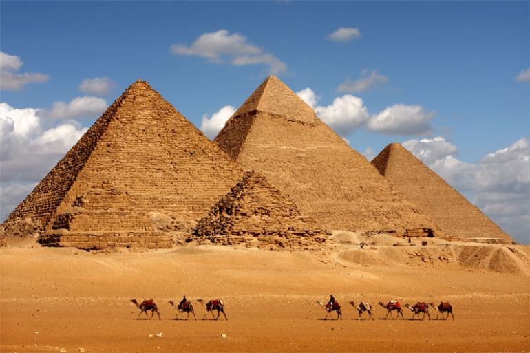saddle up a camel around the Greeat Pyramids