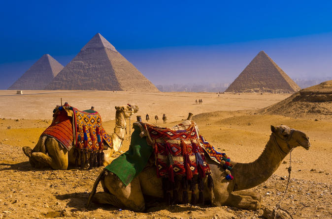 Half Day Tour to Giza Pyramids & Solar Boat Museum with Camel Ride